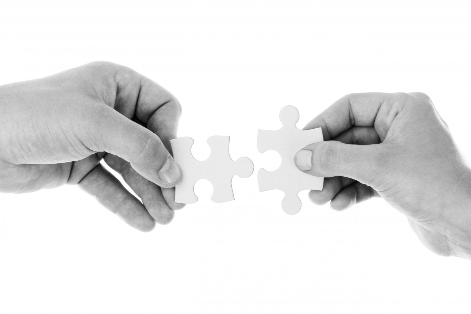image of two puzzle pieces for marketing and hrm